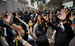 Pro-democracy supporters make hand signs outside the West Kowloon court in Hong Kong on March 1, 2021, ahead of court appearances by dozens of dissidents charged with subversion in the largest use yet of Beijing's sweeping new national security law. Peter PARKS / AFP