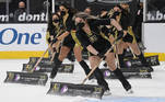 LAS VEGAS, NEVADA - MARCH 17: Members of the Knights Guard clean the ice during the Vegas Golden Knights' game against the San Jose Sharks at T-Mobile Arena on March 17, 2021 in Las Vegas, Nevada. The Golden Knights defeated the Sharks 5-4. Ethan Miller/Getty Images/AFP Ethan Miller / GETTY IMAGES NORTH AMERICA / Getty Images via AFP