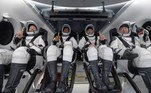 This handout image courtesy of NASA and made available on May 2, 2021, shows NASA astronauts from left:- Shannon Walker, Victor Glover, Mike Hopkins, and Japan Aerospace Exploration Agency (JAXA) astronaut Soichi Noguchi, strapped in their seats inside the SpaceX Crew Dragon Resilience spacecraft onboard the SpaceX GO Navigator recovery ship shortly after having landed in the Gulf of Mexico off the coast of Panama City, Florida, on May 2, 2021. NASA's SpaceX Crew-1 mission was the first crew rotation flight of the SpaceX Crew Dragon spacecraft and Falcon 9 rocket with astronauts to the International Space Station as part of the agency's Commercial Crew Program. Bill INGALLS / (NASA/Bill Ingalls) / AFP