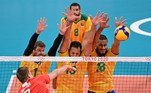 (L-R) Russia's Dmitry Volkov hits the ball in front of Brazil's Bruno Rezende, Mauricio de Souza and Ricardo Souza in the men's preliminary round pool B volleyball match between Brazil and Russia during the Tokyo 2020 Olympic Games at Ariake Arena in Tokyo on July 28, 2021. ANGELA WEISS / AFP