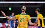 Brazil's Alan Souza celebrates victory in the men's preliminary round pool B volleyball match between Brazil and Argentina during the Tokyo 2020 Olympic Games at Ariake Arena in Tokyo on July 27, 2021. Yuri Cortez / AFP