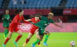 China's midfielder Yang Lina (L) fouls Zambia's midfielder Grace Chanda (R) during the Tokyo 2020 Olympic Games women's group F first round football match between China and Zambia at the Miyagi Stadium in Miyagi on July 24, 2021. Kohei CHIBAHARA / AFP