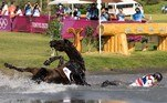 Thailand's Arinadtha Chavatanont and Boleybawn Prince fall during the equestrian's eventing team and individual cross country during the Tokyo 2020 Olympic Games at the Sea Forest Cross Country Course in Tokyo on August 1, 2021. Yuki IWAMURA / AFP