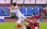 Japan's midfielder Hina Sugita (L) is tackled by Chile's defender Daniela Pardo (R) during the Tokyo 2020 Olympic Games women's group E first round football match between Chile and Japan at the Miyagi Stadium in Miyagi on July 27, 2021. Kohei CHIBAHARA / AFP