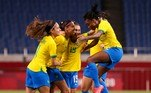 Brazil's midfielder Andressa (2L) celebrates with teammates after scoring the first goal during the Tokyo 2020 Olympic Games women's group F first round football match between Brazil and Zambia at the Saitama Stadium in Saitama on July 27, 2021. Ayaka Naito / AFP