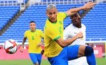 Brazil's forward Richarlison (L) fights for the ball with Ivory Coast's defender Zie Ouattara (R) during the Tokyo 2020 Olympic Games men's group D first round football match between Brazil and Ivory Coast at the Yokohama International Stadium in Yokohama on July 25, 2021. Yoshikazu TSUNO / AFP