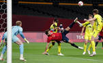 Spain's forward and captain Mikel Oyarzabal (C) attempts to shoot among Australia's defenders during the Tokyo 2020 Olympic Games men's group C first round football match between Australia and Spain at Sapporo Dome in Sapporo on July 25, 2021. ASANO IKKO / AFP