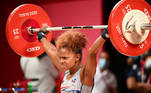 Dominican Republic's Beatriz Elizabeth Piron Candelario competes in the women's 49kg weightlifting competition during the Tokyo 2020 Olympic Games at the Tokyo International Forum in Tokyo on July 24, 2021. Vincenzo PINTO / AFP