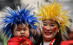 Chinese fans attend the qualifying play-off second leg women's football match for the Tokyo 2020 Olympic Games between China and South Korea at Suzhou Olympic Sports Centre Stadium in Suzhou, Jiangsu province on April 13, 2021. Hector RETAMAL / AFP