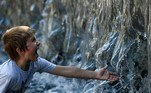 A boy cools off in a fountain during a hot summer day in downtown Moscow on July 13, 2021. Russia's meteorological service said on July 13, 2021 the country could see its hottest summer on record, driven by climate change, after a record-breaking heatwave in June. Moscow was hit by a historic heat wave at the end of June, with temperatures reaching a 120-year record.  Kirill KUDRYAVTSEV / AFP