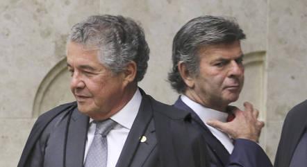 Os ministros Marco Aurélio Mello (à esq.) e Luiz Fux durante julgamento no STF