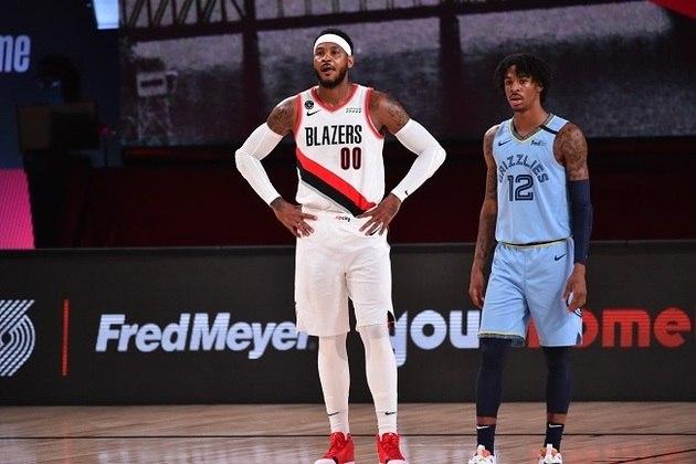 Aos 36 anos, Carmelo Anthony (Portland Trail Blazers) fez uma mudança radical em seu corpo durante o período em que a NBA não teve jogos e perdeu bastante peso para voltar a jogar como ala. Seu sacrifício foi recompensado no fim do tempo regulamentar, quando acertou duas cestas de três seguidas. Ele produziu 21 pontos e sete rebotes