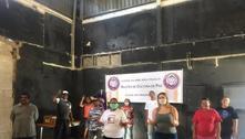 Líderes comunitários lutam para afastar pandemia das favelas