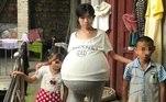 Huang Guoxian é uma chinesa que tem dois filhos e uma barriga que misteriosamente não para de crescer há dois anos. Segundo medições amadoras, já são mais de 20 kg acomodados no abdômen