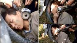 Bêbado dorme com a cabeça presa em escapamento ()