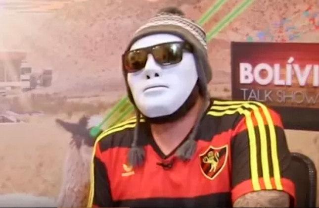 """Bolívia - Um dos primeiros integrantes do Desimpedidos e agora dono do canal """"Camisa 21"""", que possui 266 mil inscritos e conta com as tradicionais entrevistas esportivas do quadro """"Bolívia Talk Show"""", o apresentador e youtuber é corinthiano."""