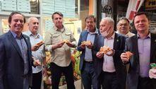 Na chegada a Nova York, Bolsonaro come pizza de pé com ministros