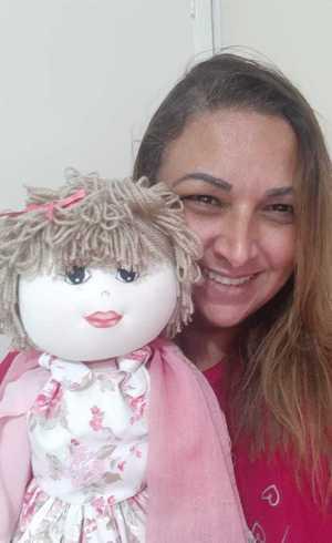 Professora com sua boneca Lene