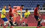 Spain's goalkeeper Unai Simon (C) jumps for the ball and collides with Brazil's Matheus Cunha during the Tokyo 2020 Olympic Games football competition men's gold medal match at Yokohama International Stadium in Yokohama, Japan, on August 7, 2021. Anne-Christine POUJOULAT / AFP AF