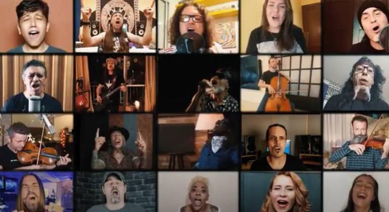 """Cantores e músicos de diferentes estilos entoam a canção """"Dar as Mãos"""""""