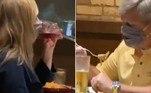 O casal acima chocou internautas ao ser flagrado enquanto comia e bebia através de máscaras de proteção contra o novo coronavírus