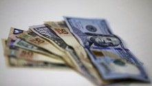 Dólar ronda estabilidade contra real e caminha para perda semanal