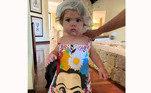 'Deusa usando nos seus 1 ano e 3 meses uma roupa que eu usava aos 4 anos', escreveu Tatá na legenda da foto, 'Com 5 anos minha filha terá minha altura. Em quantos anos sua idade será o dobro da idade de João?'