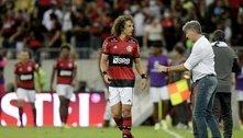 David Luiz sendo recuperado para duas decisões. Contra o Atlético e, principalmente, contra o Palmeiras