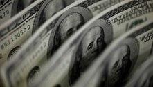 Em dia de retorno aos negócios, dólar opera em queda ante real