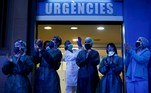 epa08429207 Health workers react as neighbors of the Dos de Mayo Hospital take part in the nationwide daily gratitude applause in Barcelona, Spain, 30 March 2020 (re-issued 18 May 2020). As prominent in both sky and sea, the color blue is often associated with open spaces, freedom, depth and wisdom. In psychology blue is viewed as a non-threatening color and it is believed to have positive and calming effects on body and mind. Often linked with intellect, confidence and reliability, it is known in corporate America as a power color. EPA/QUIQUE GARCIA ATTENTION: This Image is part of a PHOTO SET *** Local Caption *** 55993199