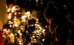 Paris (France).- A woman prays next to a silhouetted rose in the golden light of hundreds of candles lit to mark the one-year anniversary of the Paris attacks in front of the monument on Place de la Republique in Paris, France, 13 November 2016 (reissued 27 May 2020). Gold is considered a majestic color that symbolizes wealth and luxury. It is associated with success, achievement, and triumph, but it can also be deemed decadent and overindulgent. Connected with prestige and elegance, gold symbolizes divinity, power, and wisdom in many religions due to its association with masculine energy and the power of the sun. (Atentado, Francia) EFE/EPA/IAN LANGSDON ATTENTION: This Image is part of a PHOTO SET *** Local Caption *** 53117339