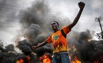 Nairobi (Kenya).- A supporter of the opposition coalition the National Super Alliance (NASA) and its presidential candidate Raila Odinga reacts in front of a burning barricade he and othes set up to block vehicles from delivering electoral materials to the polling stations in the areas in Kibera slum, in Nairobi, Kenya, 25 October 2017 (reissued 14 May 2020). Orange is the color that envelopes tires that burn in the streets during social unrest and the flames that turn structures to ash during four-alarm fires. It is the color of the lava that flows down the facades of volcanoes and the color of fireworks that illuminate the skies as people gather to celebrate the new year. (Incendio, Kenia) EFE/EPA/DAI KUROKAWA ATTENTION: This Image is part of a PHOTO SET *** Local Caption *** 53855035