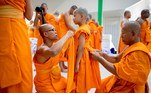 Pathum Thani (Thailand).- Thai Buddhist monks help a newly ordained young novice put on his robe at the International Dhammadayada Ordination Program, an international mass ordination ceremony held to mark the Buddhist Lent at Wat Phra Dhammakaya temple in Pathum Thani province, on the outskirts of Bangkok, Thailand, 20 July 2019 (reissued 14 May 2020). Orange is the color that envelopes tires that burn in the streets during social unrest and the flames that turn structures to ash during four-alarm fires. It is the color of the lava that flows down the facades of volcanoes and the color of fireworks that illuminate the skies as people gather to celebrate the new year. (Incendio, Tailandia) EFE/EPA/DIEGO AZUBEL ATTENTION: This Image is part of a PHOTO SET *** Local Caption *** 55349940