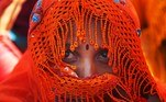 Karachi (Pakistan).- A Pakistani working woman attends a rally to demand works rights on the International Labour Day, Karachi, Pakistan, 01 May 2019 (reissued 14 May 2020). Orange is the color that envelopes tires that burn in the streets during social unrest and the flames that turn structures to ash during four-alarm fires. It is the color of the lava that flows down the facades of volcanoes and the color of fireworks that illuminate the skies as people gather to celebrate the new year. (Incendio) EFE/EPA/SHAHZAIB AKBER ATTENTION: This Image is part of a PHOTO SET