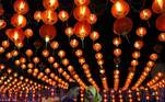 Solo (Indonesia), 27/01/2017.- Local people gather under the Chinese lampion to celebrate the Chinese Lunar New Year at Gedhe traditional market, Solo, Central Java, Indonesia, 27 January 2017 (reissued 14 May 2020). Orange is the color that envelopes tires that burn in the streets during social unrest and the flames that turn structures to ash during four-alarm fires. It is the color of the lava that flows down the facades of volcanoes and the color of fireworks that illuminate the skies as people gather to celebrate the new year. (Incendio) EFE/EPA/ALI LUTFI ATTENTION: This Image is part of a PHOTO SET