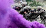 Vaziani (Georgia).- Georgian soldiers move forward behind purple smoke during the joint multinational military exercise 'Noble Partner 2018' at the military base of Vaziani, outside Tbilisi, Georgia, 09 August 2018 (reissued 20 May 2020). Situated between the hues of red and blue, the color purple is widely considered both energetic and relaxing. Because of its rarity in nature and historic use by royals and high-ranked priests, purple still conjures connotations of luxury, regality, wealth and power. EFE/EPA/ZURAB KURTSIKIDZE ATTENTION: This Image is part of a PHOTO SET