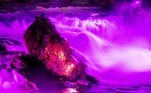 Neuhausen (Switzerland Schweiz Suisse).- The Rheinfall (Rhine Falls) illuminated in shades of pink and purple in Neuhausen, Switzerland, 29 October 2017 (reissued 20 May 2020). Situated between the hues of red and blue, the color purple is widely considered both energetic and relaxing. Because of its rarity in nature and historic use by royals and high-ranked priests, purple still conjures connotations of luxury, regality, wealth and power. (Suiza) EFE/EPA/WALTER BIERI ATTENTION: This Image is part of a PHOTO SET *** Local Caption *** 53863819
