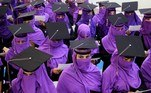 Kandahar (Afghanistan).- Afghan female students wear purple for their graduation ceremony in Kandahar, Afghanistan, 01 July 2019 (reissued 20 May 2020). Situated between the hues of red and blue, the color purple is widely considered both energetic and relaxing. Because of its rarity in nature and historic use by royals and high-ranked priests, purple still conjures connotations of luxury, regality, wealth and power. (Afganistán) EFE/EPA/MUHAMMAD SADIQ ATTENTION: This Image is part of a PHOTO SET