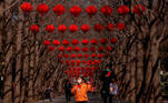 Beijing (China), 05/02/2021.- People walk past trees decorated with red lanterns to celebrate the upcoming Chinese Lunar New Year, at Ditan Park in Beijing, China, 05 February 2021. The Lunar New Year, also known as Spring Festival, falls on 12 February 2021, marking the beginning of the Year of the Ox. EFE/EPA/ROMAN PILIPEY