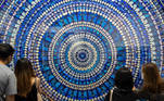 Hong Kong (China), 19/05/2021.- Visitors look at Damien Hirst's art piece entitled 'Martyr, 2019' at Art Basel Hong Kong 2021 in Hong Kong, China, 19 May 2021. The art fair is back in the city after cancellation last year and features with 104 exhibitors from 23 countries. (Basilea) EFE/EPA/JEROME FAVRE
