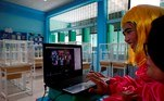 Bangkok (Thailand), 29/06/2021.- Thai mathematics teachers Nootsara Bungbai (L) and Chorpaka Hansuwan (R) are dressed in fancy costumes as they conduct a live online class at Suraomai school in Bangkok, Thailand, 29 June 2021. Amid the norm of remote learning caused by the COVID-19 pandemic, teachers of the Suraomai school in Bangkok wear makeup and dress in colorful costumes while conducting teaching online classes aimed to encourage and engage their students more in the lessons. (Tailandia) EFE/EPA/RUNGROJ YONGRIT