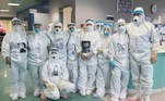 Prato (Italy), 27/11/2020.- Doctors and nurses pose for a group photo at the intensive care unit for COVID-19 patients in the hospital in Prato, Italy, 27 November 2020. As the medical personnel has to wear full protection gear with suits, mouth-and-nose masks and face shields, the doctors and nurses have printed photos of themselves on their suits. (Italia) EFE/EPA/CLAUDIO GIOVANNINI