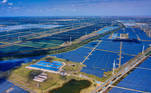 """Yancheng (China), 14/10/2020.- A photo made with a drone shows general view of the solar panels and wind turbines of Wind, Solar and Fishing Base in Dongtai near Yancheng, Jiangsu province, China, 14 October 2020. The largest integrated power station of """"Wind, Solar and Fishing"""" Complementary Industry Base in China and the world's largest single-scale tidal flat industrial base. It can produce 120 million kWh of clean energy for 80,000 households. There is wind power generation in the upper part, photovoltaic utilisation in the middle part, and fishing aquaculture in the lower part, and the development and utilisation of coastal beach resources are maximised. EFE/EPA/ALEX PLAVEVSKI ATTENTION: This Image is part of a PHOTO SET"""
