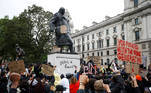 ATTENTION EDITORS - SENSITIVE MATERIAL. THIS IMAGE MAY OFFEND OR DISTURB Demonstrators react infront of graffiti on a statue of Winston Churchill in Parliament Square during a Black Lives Matter protest in London, following the death of George Floyd who died in police custody in Minneapolis, London, Britain, June 7, 2020. REUTERS/Peter Nicholls