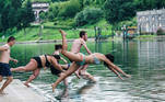 Turin (Italy), 12/07/2020.- Participants jump in the river Po during the event of Legambiente 'Big Jump a dip in the river Po', to raise public awareness on the quality of water in Turin, Italy, 12 July 2020. (Italia) EFE/EPA/TINO ROMANO