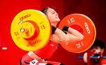 Tokyo (Japan), 24/07/2021.- Bronze medallist Windy Cantika Aisah of Indonesia competes in the Group A Women's 49kg - Clean & Jerk during the Weightlifting events of the Tokyo 2020 Olympic Games at the Tokyo International Forum in Tokyo, Japan, 24 July 2021. (Japón, Tokio) EFE/EPA/RITCHIE B. TONGO