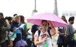 Em Curitiba, o tempo foi de chuva. Inscritos foram vistos se deslocando a pé debaixo de guarda-chuvas