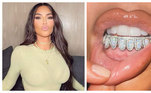 Kim Kardashian deu o que falar após exibirexibir o novo sorriso. A socialite colocou grillz de diamante nos dentes.'Alerta de grillz de opala e diamante', escreveu Kim na legenda da imagem, ostentando o acessório.Nos comentários, fãs e seguidores alfinetaram a escolha dela. 'Kim, tem pessoas morrendo', escreveu uma internauta.'Os ricos simplesmente não sabem mais o que fazer com o dinheiro', postou mais um. 'Por que? Doe para quem tem fome', sugeriu outro.'As pessoas perderam seus empregos na pandemia, perderam suas casas e você postou isso?? É assustador', criticou mais uma seguidora