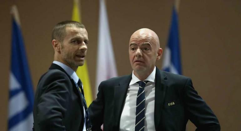 Presidente da Uefa, Ceferin, e o da Fifa, Infantino. Sanções legais contra clubes e atletas