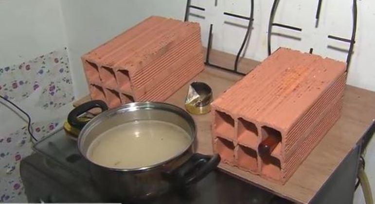 Famílias improvisam fogareiro com etanol para cozinhar devido à alta do preço do gás
